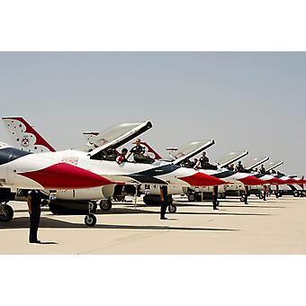 Airmen conduct preflight preparations on F-16 Thunderbirds Poster Print by Stocktrek Images