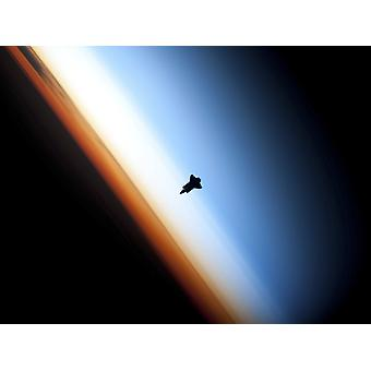 February 9 2010 - Silhouette of space shuttle Endeavour over Earths colorful horizon Poster Print