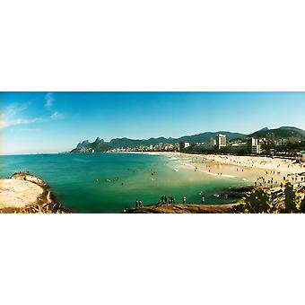 Tourists on the beach Ipanema Beach Rio de Janeiro Brazil Poster Print