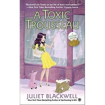 A Toxic Trousseau - A Witchcraft Mystery by Juliet Blackwell - 9780451