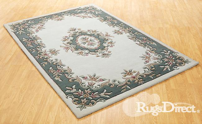 Royal Indian Cream-Green The design is in shades of green, beige and rose on a cream background Half Moon Rugs Traditional Rugs