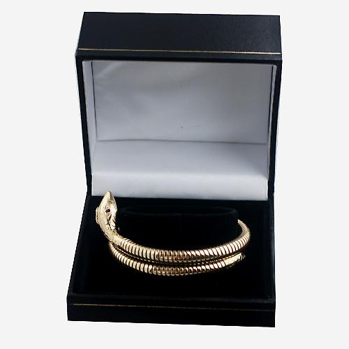 9ct Gold single coil Snake armlet set with Ruby eyes
