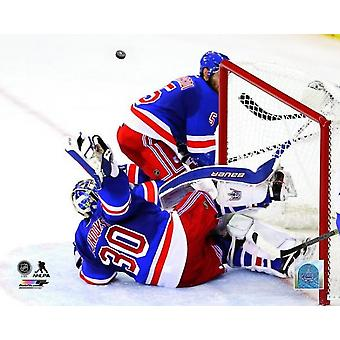 Henrik Lundqvist makes a save against the Montreal Canadiens during Game Six of the Eastern Conference Finals of the 2014 NHL Stanley Cup Playoffs at Madison Square Garden on May 29 2014 Photo Print (