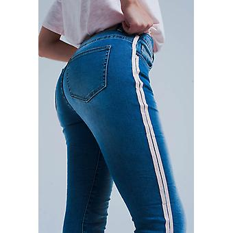 Skinny jeans with side seam stripes