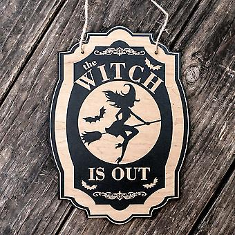 The witch is out - black halloween door sign