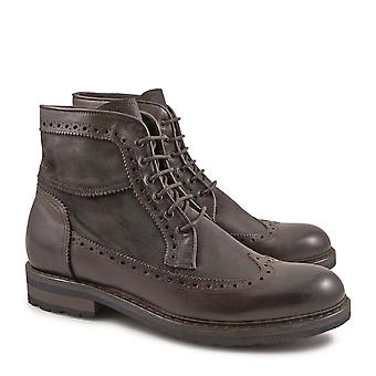 Handmade men's wingtip boots in vintage chocolate leather