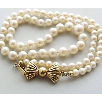 Pearl Necklace with gold bow lock