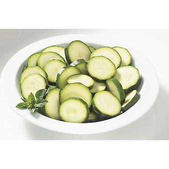 Grüns in Scheiben geschnittene Zucchini eingefroren