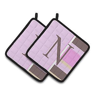 Письмо N первоначальный монограммой - розовые полосы пара прихватки