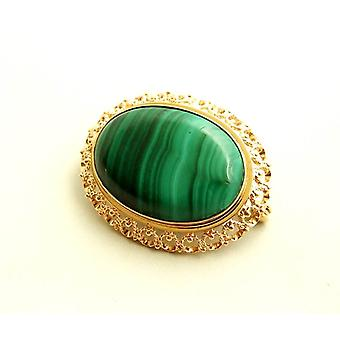 Gold brooch with Malachite