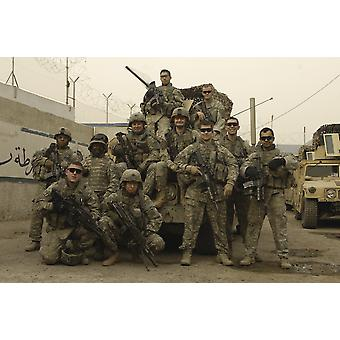 February 18 2008 - US Army Soldiers assigned to weapons squad 1st Platoon Charlie Company 1st Battalion 504th Parachute Infantry Regiment pose for a photo before patrolling Rusafa Baghdad Iraq Poster