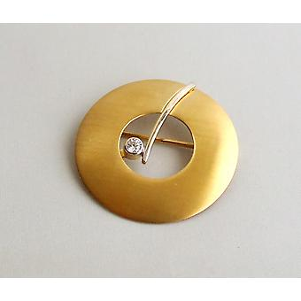 Gold brooch with zirconia