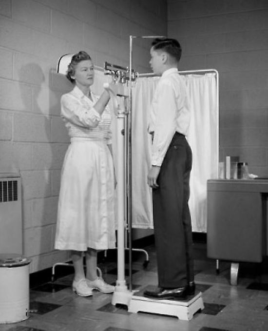 Female nurse measubague height and weight of a boy Poster Print