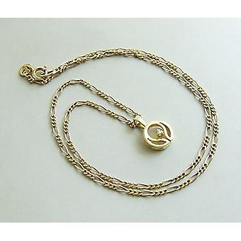 Begagnad bil guld halsband och hänge med diamant