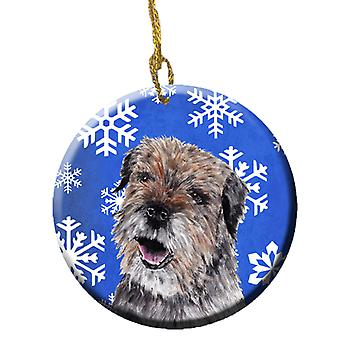 Carolines Treasures  SC9599CO1 Border Terrier Winter Snowflakes Ceramic Ornament