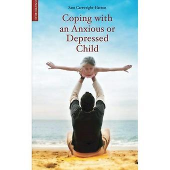 Lidar com uma criança ansiosa ou deprimida: um guia para pais e encarregados de educação (lidar com (Oneworld))