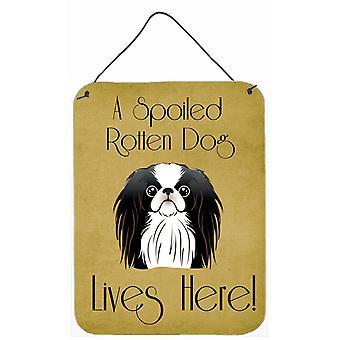 Chin japonés perro estropeado vidas aquí la pared o la puerta colgando impresiones