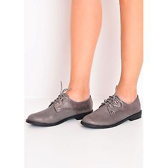la dentelle métallique place Broglie chaussures gris