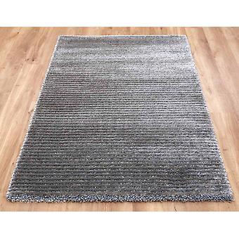 Spettro a righe metà tappeto grigio
