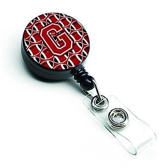 Letra G fútbol rojo, blanco y negro insignia Retractable carrete