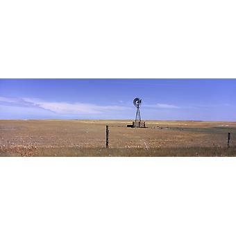 Mulino a vento industriale su un paesaggio autostrada 271 Oglala National Grassland Sioux County Nebraska USA stampa del manifesto