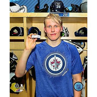 Patrik Laine holds the puck from his first NHL Goal- October 13 2016 Photo Print (8 x 10)