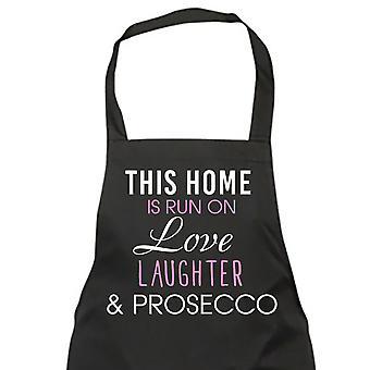 Esta casa se ejecuta en amor risas y Prosecco delantal