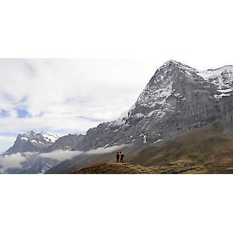 Hikers standing on a hill Mt Eiger Kleine Scheidegg Bernese Oberland Bern Switzerland Poster Print