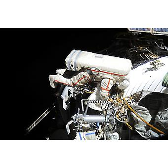 Russian cosmonaut during a session of extravehicular activity Poster Print
