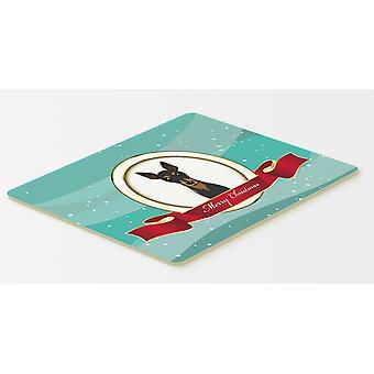 Carolines trésors BB1550CMT Min Pin joyeux Noël cuisine ou tapis de bain 20 x 30