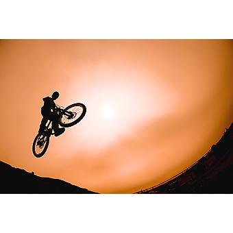 Silhouette Of Stunt Cyclist PosterPrint