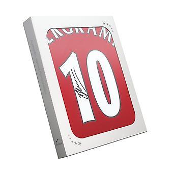 Dennis Bergkamp undertecknat Arsenal hem skjorta i presentask