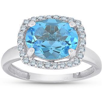 2CT ovale topaze bleue et diamants Halo anneau d'or blanc 10 K