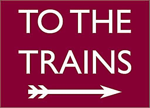 To The Trains (maroon, to right) enamelled steel wall sign    (dp)
