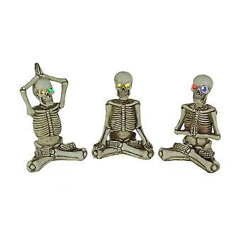 Bone stretchers yoga skelett Figurines med färg förändras LED ögon uppsättning av 3